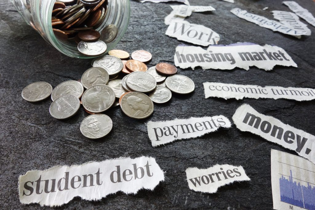 to be in debt