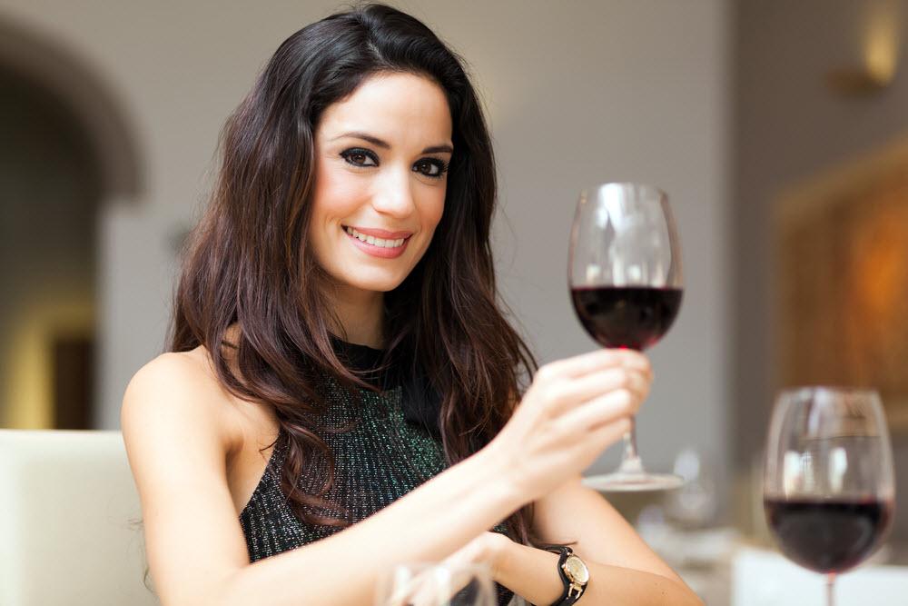 treat yourself - woman drinking wine